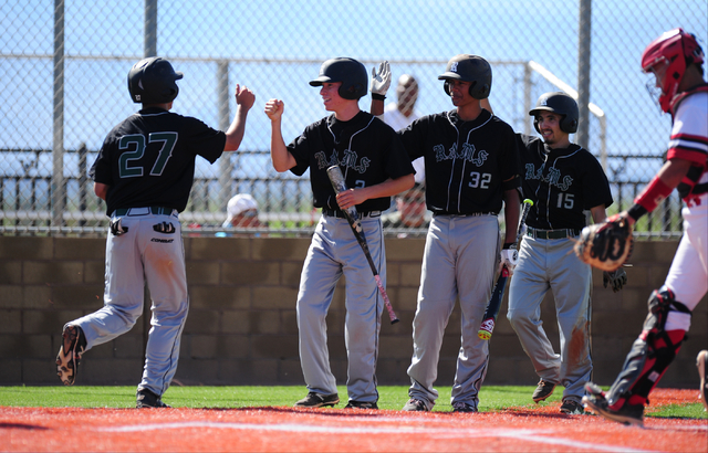 Rancho baserunner Anthony Guzman (27) high fives teammates after he scored a run against Las Vegas in the second inning of their prep baseball game at Las Vegas High School Tuesday, May 3, 2016. R ...