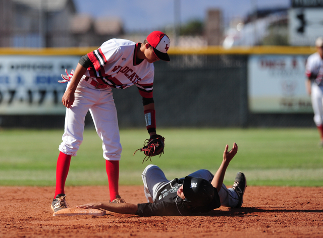 Las Vegas shortstop Nathan Freimuth tags out Rancho baserunner Anthony Guzman after Guzman tried to steal second base in the fourth inning of their prep baseball game at Las Vegas High School Tues ...