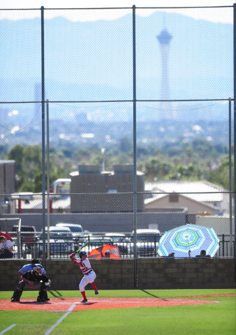 With the Stratosphere tower as a backdrop, Las Vegas batter Jason Herrera stands at the plate in the fourth inning of their prep baseball game against Rancho at Las Vegas High School Tuesday, May  ...