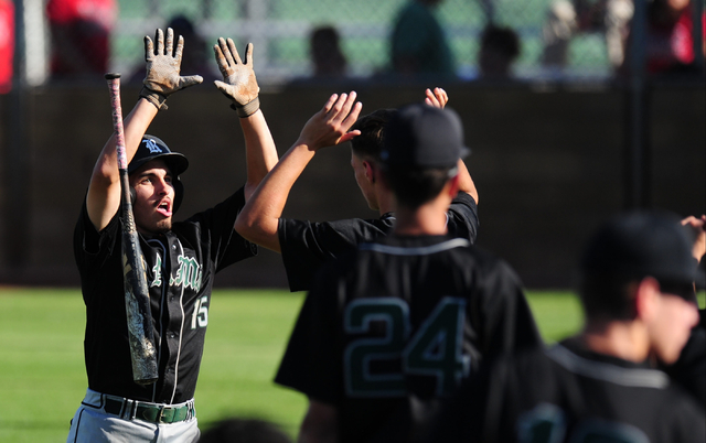 Rancho baserunner Braulio Santiaguin high fives teammates after scoring a run in the sixth inning of their prep baseball game against Las Vegas at Las Vegas High School Tuesday, May 3, 2016.Rancho ...