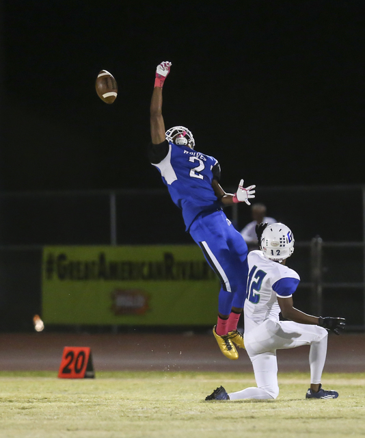 Basic's DeShawn Eagles comes up short on a pass during a football game against Green Valley at Basic High School in Henderson on Friday, Oct. 14, 2016. Chase Stevens/Las Vegas Review-Journal Follo ...