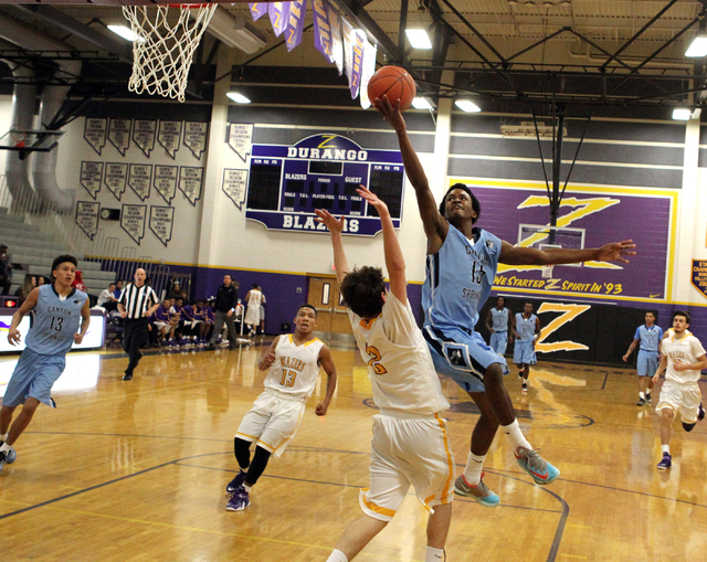 Canyon Springs guard Derrick Legardy (15) goes up for a shot over Durango guard Alex Tarkanian (2) in the third quarter on Tuesday. Legardy provided a spark off the bench with seven points, six re ...