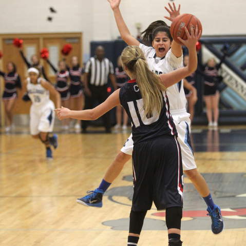 Coronado guard Payton Caci looks to pass over Centennial guard De'janea Childs in the third quarter on Wednesday. Centennial won, 72-41. (K.M. Cannon/Las Vegas Review-Journal)