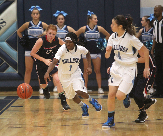 Centennial guard Pam Wilmore (1) goes for a loose ball in front of Coronado guard Katie Thorn (13) in the second quarter on Wednesday. The sophomore led all scorers with 19 points as Centennial wo ...