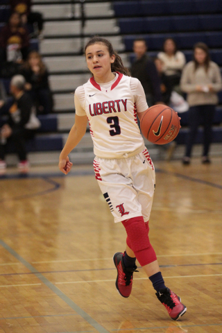 Liberty's CeCe Quintino (3) brings the ball down the curt during the first half against Skyline (Utah) on Thursday. (Donavon Lockett/Las Vegas Review-Journal)