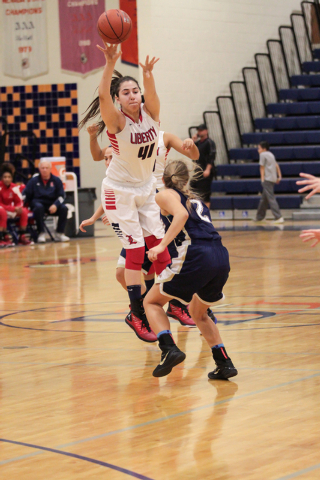 Liberty's Nancy Caballero (41) leaps up and out while passing the ball over the head of Skyline's Shaylana Davis (2) during the first half on Thursday. (Donavon Lockett/Las Vegas Review-Journal)