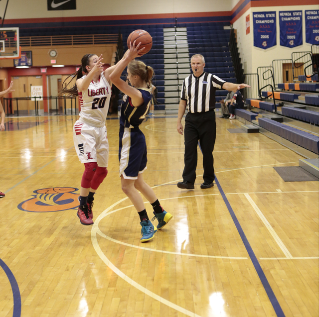 Liberty's Kealy Brown (20) defends Skyline's Hannah Anderl (15) during the second half on Thursday. (Donavon Lockett/Las Vegas Review-Journal)