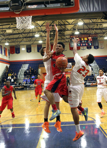 Findlay Prep guard Allonzo Trier (4) goes up for a shot between Wasatch Academy forward/center Josip Vrankic, left, and guard/forward Shamiel Stevenson (23) in the first half on Wednesday in ther  ...