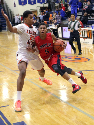 Findlay Prep point guard Derryck Thornton Jr. (5) drives past Wasatch Academy guard/forward Shamiel Stevenson (23) in the Tarkanian Classic on Wednesday. Findlay Prep won, 80-52. (K.M. Cannon/Las  ...