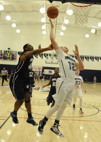 Agassi Prep forward Darius Coaxum, left, fouls The Meadows School guard Ethan Fridman (12) in the second quarter on Saturday. The Stars beat the Mustangs, 68-63. (Josh Holmberg/Las Vegas Review Jo ...