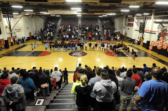 Players and fans from both Las Vegas High and Canyon Springs observe a moment of silence in honor of the passing of former UNLV coach Jerry Tarkanian before the start of their prep basketball game ...
