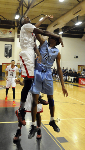 The arm of Las Vegas High guard Deshawn Weathers, left, knocks the glasses off of Canyon Springs forward Darion Jackson (14) during the first quarter on Wednesday. (Josh Holmberg/Las Vegas Review  ...