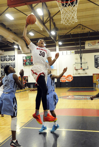 Las Vegas High forward Tyler Bey (30) dunks against Canyon Springs during the third quarter on Wednesday. Bey scored 25 points as the Wildcats beat the Pioneers, 77-51. (Josh Holmberg/Las Vegas Re ...