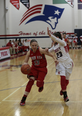 Arbor View's Katrina Nordstrom (13) tries to move around Liberty's Alexis Tomassi (23) during the second half of Monday's game at Liberty. Nordstrom had eight points, but Liberty won 59-41. (Donav ...