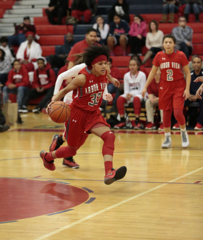 Arbor View's Janae Strode (32) makes a move down court during the first half of Monday's game at Liberty. Strode had five points and eight rebounds. Liberty won the game 59-41. (Donavon Lockett/La ...
