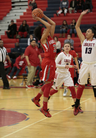 Arbor View's Janae Strode (32) takes a shot as Liberty's Aubre' Fortner (13) attempts to defend during the first half of Monday's game at Liberty. Strode had five points. Liberty won the game 59-4 ...