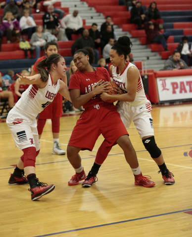 Liberty's Nancy Caballero (left) and Aubre Fortner (right) battle Arbor View's Kera Farmer for the ball during Monday's game at Liberty. Caballero had eight points in the Patriots' 59-41 win. (Don ...