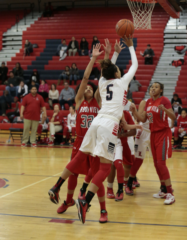 Liberty's Jaelyn Royal (5) takes a shot as Arbor View's Janae Strode tries to defend during Monday's game. Royal had two points in the Patriots' 59-41 win. (Donavon Lockett/Las Vegas Review-Journal)