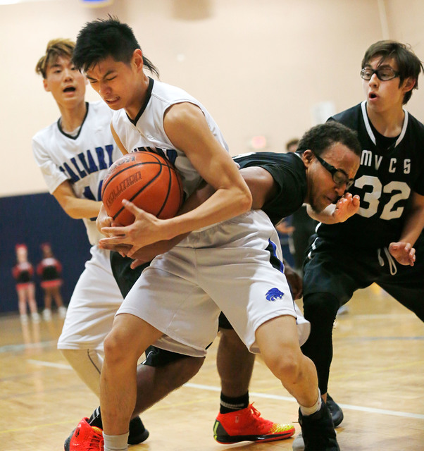 Calvary Chapel's Marior Munda, left, keeps a ball away from Mountain View's Isiah Johnson during the second half of a basketball game at Calvary Chapel Christian High School in Las Vegas, Tuesday, ...