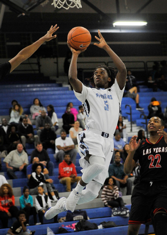 Canyon Springs' Kajuan Casey shoots against Las Vegas High on Monday. Las Vegas won, 80-62. (David Becker/Las Vegas Review-Journal)