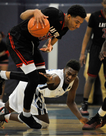 Las Vegas' Tyler Bey, left, grabs a loose ball from against Canyon Springs' D'Quan Crockett on Monday. Bey had 23 points and seven rebounds in an 80-62 Las Vegas win. (David Becker/Las Vegas Revie ...