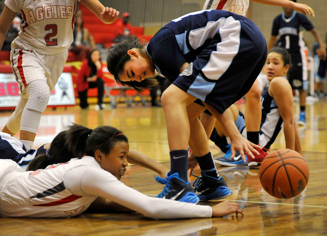 Arbor View's Ariona Gill, left and Centennial's Sarah Kruthaupt chase a loose ball on Monday. Centennial won 74-40 to clinch the Northwest League title. (David Becker/Las Vegas Review-Journal)