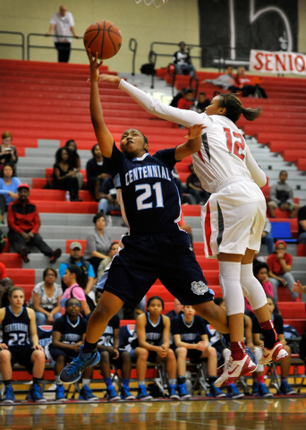 Centennial's Justice Ethridge shoots against Arbor View's Ariona Gill on Monday. Ethridge had 21 points and nine rebounds to lead the Bulldogs to a 74-40 win. (David Becker/Las Vegas Review-Journal)