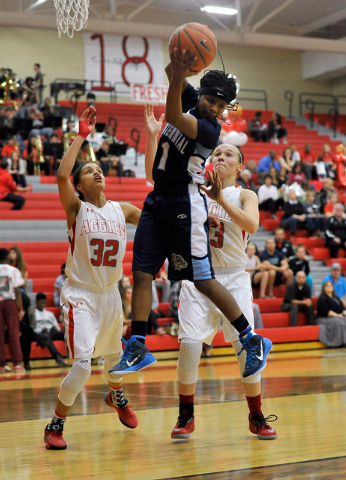 Centennial's Pam Wilmore grabs a rebound against Arbor View's Janae Strode (32) and Katrina Nordstrom on Monday. Wilmore had eight rebounds to help the Bulldogs to a 74-40 win. (David Becker/Las V ...