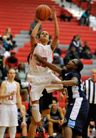 Arbor View's janae Strode shoots against Centennial's Tanjanae Wells on Monday. Strode had 12 points, but Centennial won 74-40 to clinch the Northwest League title. (David Becker/Las Vegas Review- ...