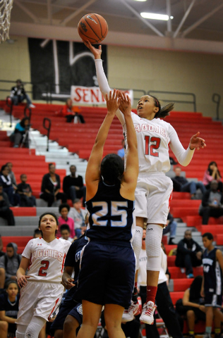 Arbor View's Ariona Gill shoots against Centennial's Karina Brandon on Monday. Gill had 10 points, but Centennial won 74-40 to clinch the Northwest League title. (David Becker/Las Vegas Review-Jou ...
