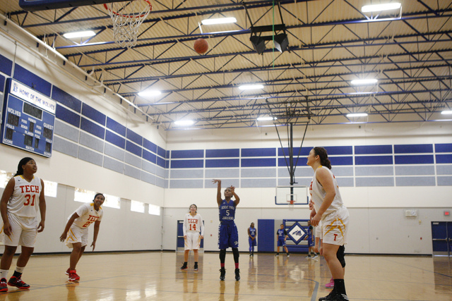 Desert Pines' Chrystian Myles (5) shoots a free throw during Tuesday's game against Tech in the Lady Wolves Holiday Tournament at Basic. Myles had six points as Desert Pines won, 20-7. (Erik Verdu ...