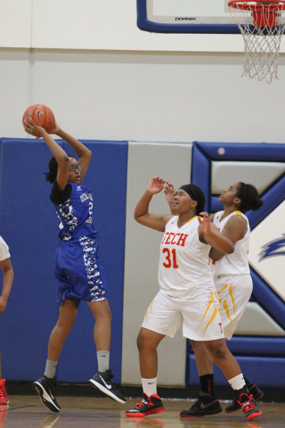 Desert Pines' Adrianne Jackson (20) looks to pass against Tech in the Lady Wolves Holiday Tournament at Basic on Tuesday. Jackson scored three points as Desert Pines won 20-7. (Erik Verduzco/Las V ...