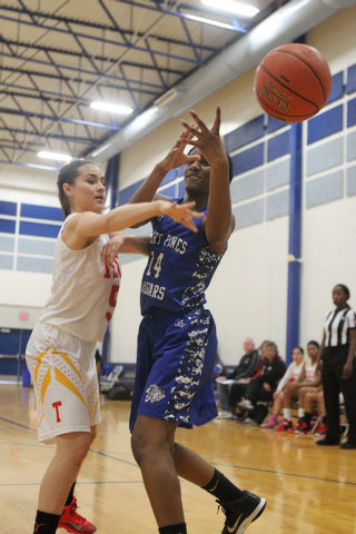 Tech's Jasmine Ramos (5) knocks the ball loose from Desert Pines Tanauya Hinton (14) during their game in the Lady Wolves Holiday Tournament at Basic on Tuesday. Desert Pines won 20-7. (Erik Verdu ...