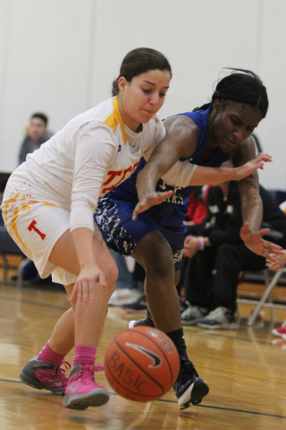 Tech's Grace Malek, left, and Desert Pines' Tanauya Hinton (14) fight for possession of the ball during  Tuesday's game in the Lady Wolves Holiday Tournament at Basic. Hinton scored two points in  ...