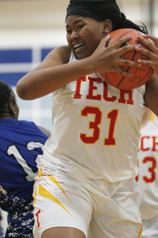 Tech's Patrice Thomas (31) grabs the ball against Desert Pines in the Lady Wolves Holiday Tournament at Basic on Tuesday. Thomas scored six points, but Desert Pines won 20-7. (Erik Verduzco/Las Ve ...