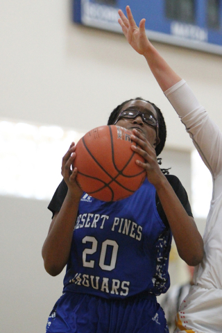 Desert Pines' Adrianne Jackson (20) looks for an open shot against Tech in the Lady Wolves Holiday Tournament at Basic on Tuesday. Jacons had three points as Desert Pines won 20-7. (Erik Verduzco/ ...