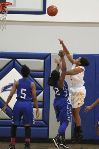 Tech's Leslie Williams (34) takes a shot over Desert Pines' See'Airrah Evans-Collins (12) during their game in the Lady Wolves Holiday Tournament at Basic on Tuesday. Williams had six points, but  ...