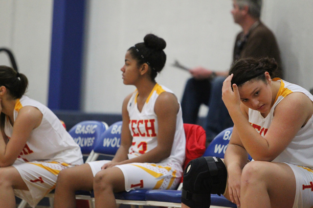 Tech's Sidney Stanton, right, reacts to a play against Desert Pines during Tuesday's game in the Lady Wolves Holiday Tournament at Basic. Desert Pines won 20-7. (Erik Verduzco/Las Vegas Review-Jou ...