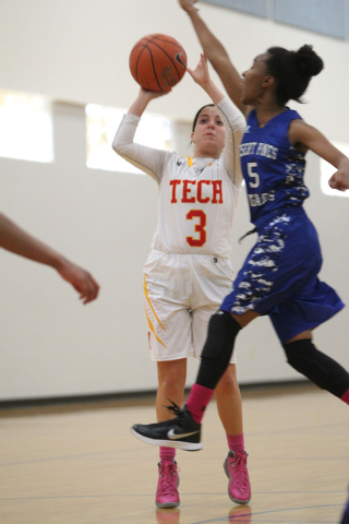 Tech's Grace Malek (3) looks for an open shot against Desert Pines' Chrystian Myles (5) during their game in the Lady Wolves Holiday Tournament at Basic on Tuesday. Desert Pines won 20-7. (Erik Ve ...