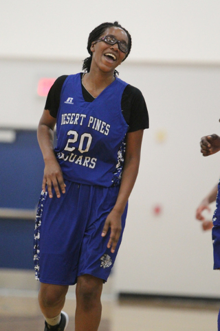 Desert Pines' Adrianne Jackson (20) reacts after making a jump shot during a game against Tech on Tuesday in the Lady Wolves Holiday Tournament at Basic. Jackson had three points as Desert Pines w ...