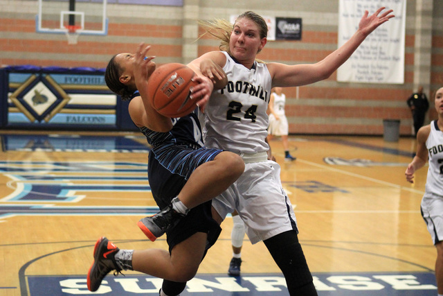 Foothill's Gabby Doxtator fouls Canyon Springs' Alize Bell on Tuesday. Doxtator had 20 points and four rebounds in a 68-60 Foothill victory. (Sam Morris/Las Vegas Review-Journal)