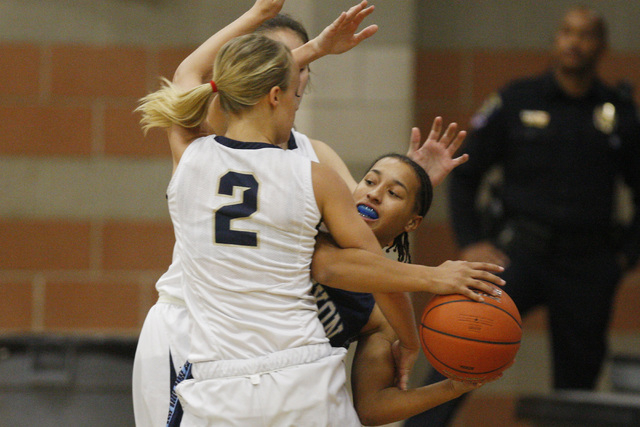 Canyon Springs' Alize Bell is fouled by Foothill's Mikayla Yeakel on Tuesday. Foothill beat Canyon Springs, 68-60. (Sam Morris/Las Vegas Review-Journal)