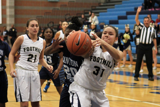 Foothill's Bri Rosales grabs a rebound from Canyon Springs' Alexia Thrower on Tuesday. Foothill beat Canyon Springs, 68-60. (Sam Morris/Las Vegas Review-Journal)
