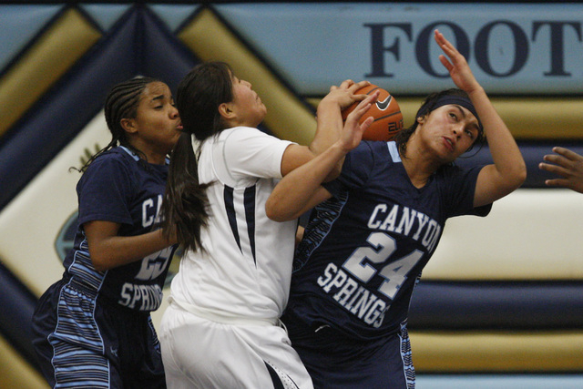 Canyon Springs' D'Licya Feaster, left, and Daijhan Cooks fight for a rebound with Foothill's Trinity Betoney on Tuesday. Foothill beat Canyon Springs, 68-60. (Sam Morris/Las Vegas Review-Journal)