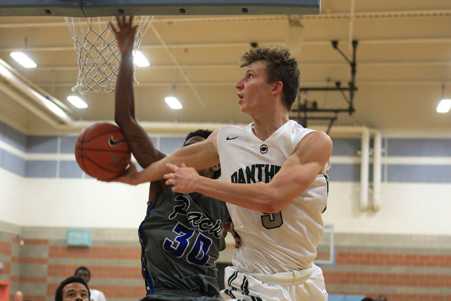 Palo Verde's Grant Dressler puts up a reverse layup while being defended by Basic forward Rob Sutton on Friday. Dressler had 22 points and seven rebounds as Palo Verde won, 78-37. (Sam Morris/Las  ...