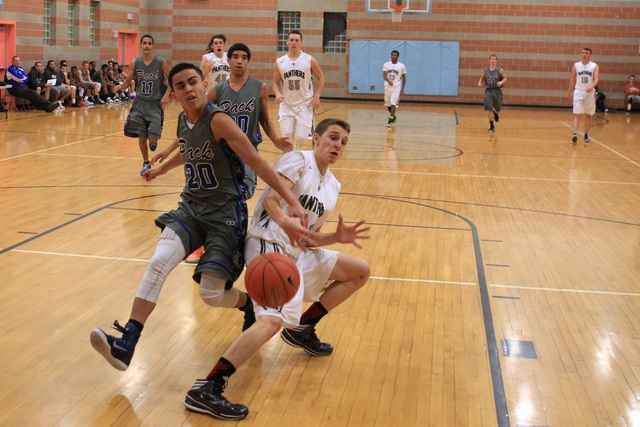 Basic guard Chaz Lucero knocks the ball out of the hands of Palo Verde's Thomas Reymond on Friday. Palo Verde won, 78-37. (Sam Morris/Las Vegas Review-Journal)