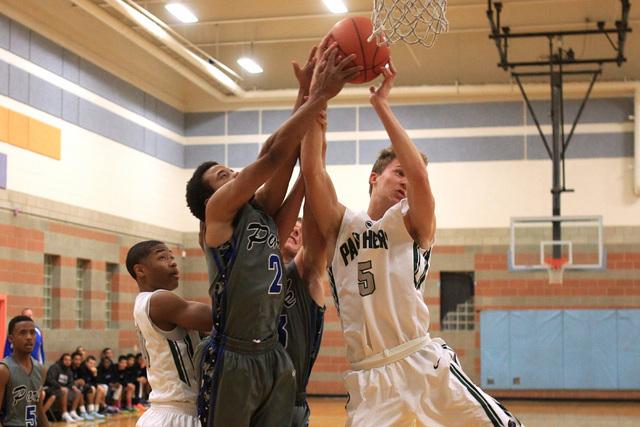 Palo Verde forward Grant Dressier grabs a rebound from Basic guard Jaimen Williams on Thursday.Dressler had 22 points and seven rebounds as Palo Verde won, 78-37. (Sam Morris/Las Vegas Review-Journal)