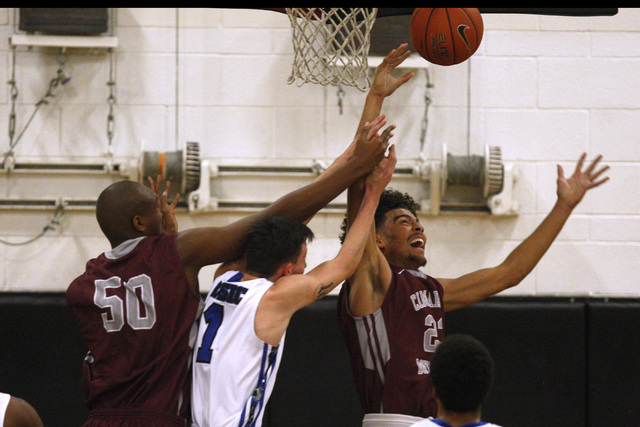 Cimarron-Memorial center Terrell Walker, left, and forward Jaron Ponder fight Basic guard Jared Meacham for a rebound during their Las Vegas Prep Championship game Friday. (Sam Morris/Las Vegas Re ...