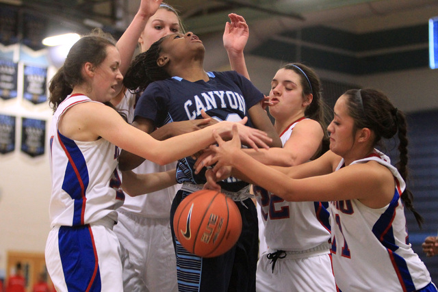 Canyon Springs guard Alexia Thrower looses the ball to Reno players, from left, Megan Dericco, Mallory McGwire, McKain Murdock and Daranda Hinkey during their Las Vegas Holiday Classic tournament  ...