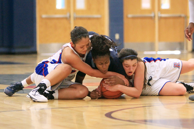 Canyon Springs guard Alexia Thrower fights for a loose ball with Reno guard Daranda Hinkey, left, and forward McKain Murdock during their Las Vegas Holiday Classic tournament game Saturday. (Sam M ...